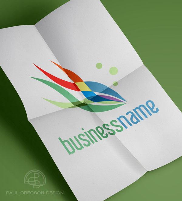 rainbow fish logo on folded paper